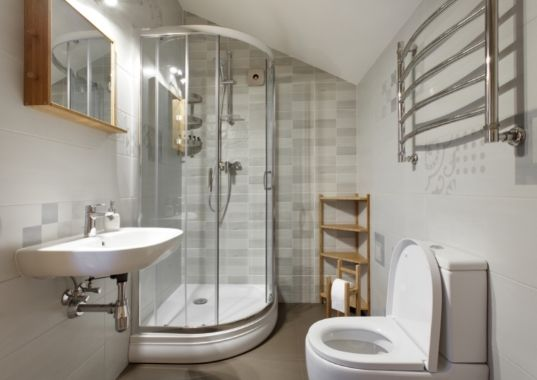 Light colored bathroom with glass enclosure and white fittings | Bunbury Bathroom Renovations